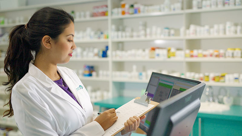 pharmacist verifying prescription