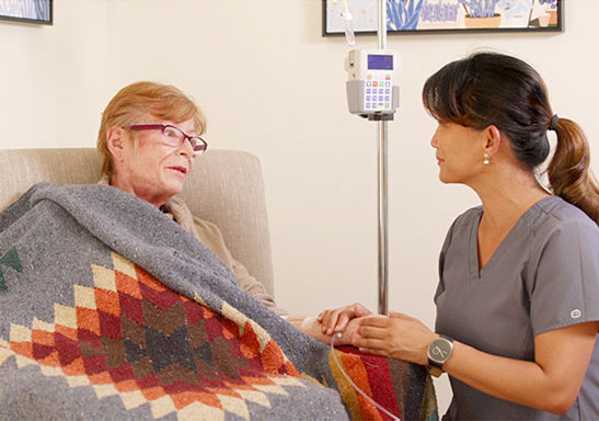 senior having home infusion with a nurse