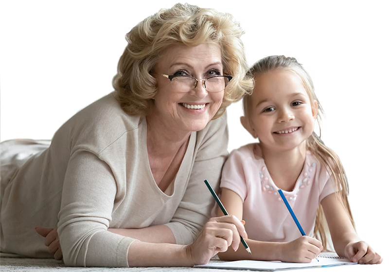 Grandmother spending time with granddaughter drawing lying on floor-800px